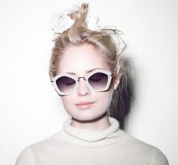 fashion woman portrait. Sunglasses Hippie hair flowers on face