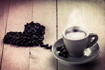Coffee in love,coffee in cup with roasted coffee bean heart shap