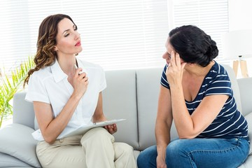 Depressed woman talking with her therapist