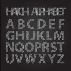 upper-case stripped alphabet on chalkboard