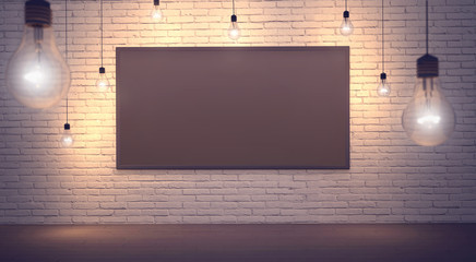 Black board in a brick loft ceiling lights