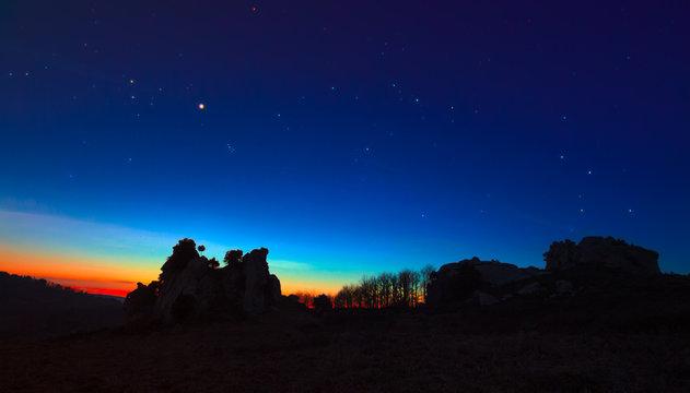 Argimusco twilight with Venus Taurus Cassiopea and Pleiades