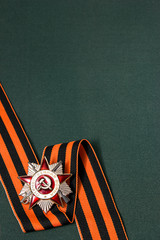 Order of the Patriotic War and St. George ribbon on green backgr
