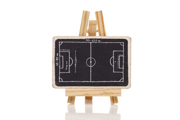 Blackboard with a drawing of a blank Football field dimensions