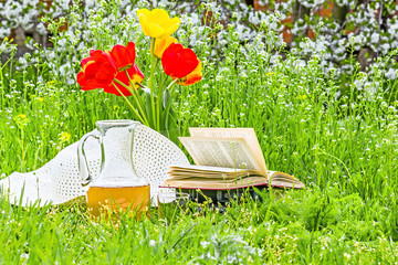Bouquet of tulips, books and white hat