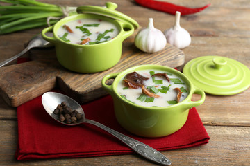 Mushroom soup on wooden background