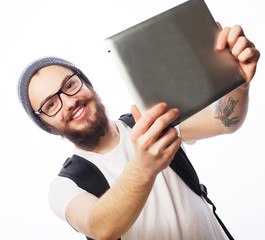 young bearded man holding tablet