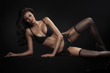 Young slim brunette lady wearing sensual lingerie