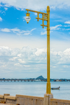 A vintage gold streetlight at seaside of Prachuap Khiri Khan bay