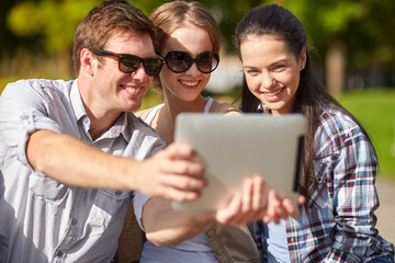 students or teenagers with tablet pc taking selfie