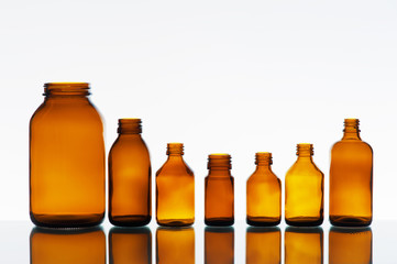 Empty medicine bottles on the light background