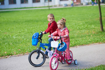 boy and girl with bicycle