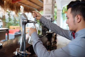 Pouring draft beer