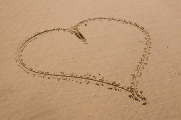 Beach background with hearts drawing on summer