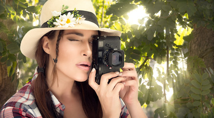 Stylish Young Woman Capturing Photos at the Forest