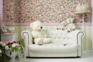 white and pink cozy room with flowers teddy bears white sofa and lamp