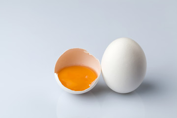 White egg and a half egg
