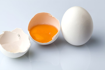 White egg and a half egg