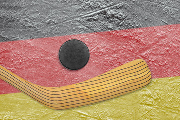 Hockey puck, hockey sticks and German flag