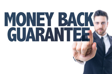 Business man pointing the text: Money Back Guarantee