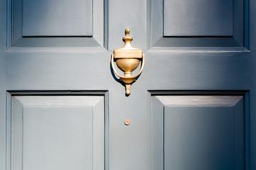 Background of vintage blue painted door and knocker vignette Fototapete