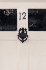 Door number twelve with door knocker