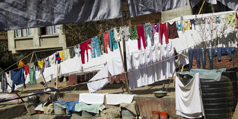 Different clothes drying on a rope in Kathmandu, Nepal