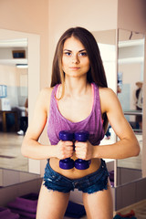 Young female swinging muscles