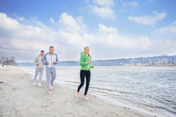 Young athletes exercising on a beach
