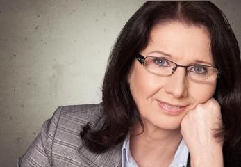 Women. Mature businesswoman smiling
