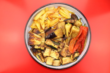 Fried vegetables (potatoes, peppers, eggplants and zucchinis)