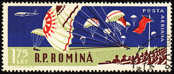 Parachutists landing in stadium  on post stamp