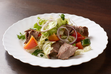 Delicious salad made of meat and vegetables