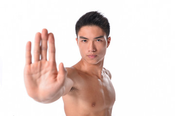 Young sexy man holding his palm out saying 'Stop' or 'No!'