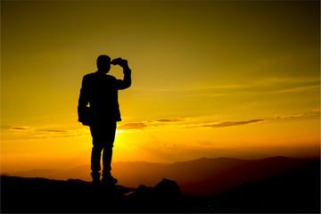 Businessman watch with binoculars