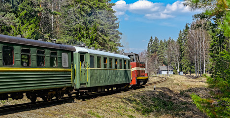 Passenger train on old narrow-gauge railway.