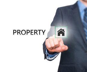 Businessman pressing property button on virtual screen