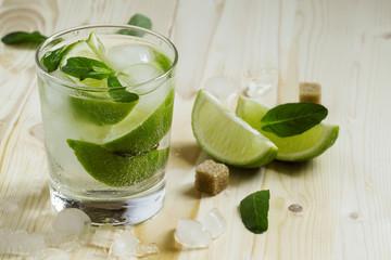 Fresh cocktail witn soda, lemon and mint, selective focus