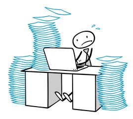 Geschäftsmann am Computer unter Zeitdruck