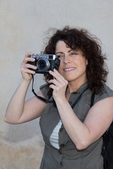 Happy and Lovely  brunette woman having photography fun.