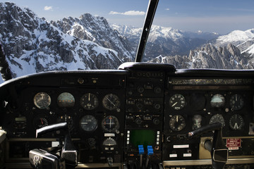 dashboard in airplane cockpit and mountains view