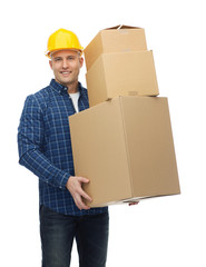 smiling man in helmet with cardboard boxes