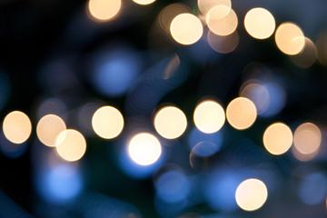 Fotobehang - bright lights on dark blue night background