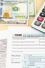 Tax form with pen, banknote, and calculator taxation concept