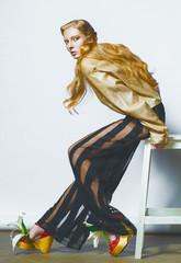 Fashion model pose on light background