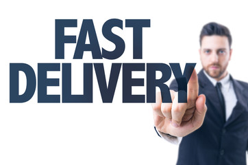 Business man pointing the text: Fast Delivery
