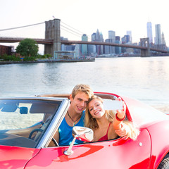 selfie young couple convertible New York Brooklyn Bridge