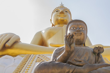 Two large statues of Buddha at Wat Hua Ta Luk,Nakorn Sawan, Thai