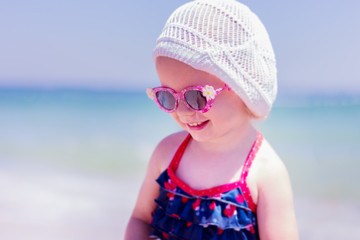 Beautiful little girl  on the beach. Selective focus.