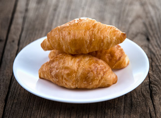 Croissant on wooden table